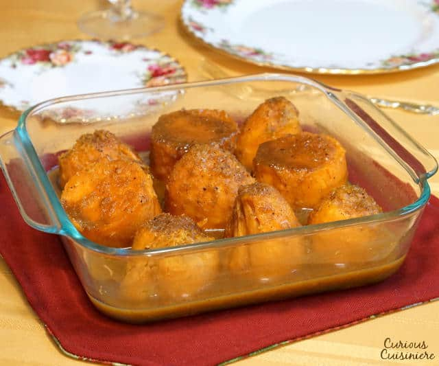 This recipe for slightly sweet, spiced and orange-flavored, Southern Candied Yams is a wonderful alternative to traditional sweet potato casserole on your holiday table. | www.CuriousCuisiniere.com