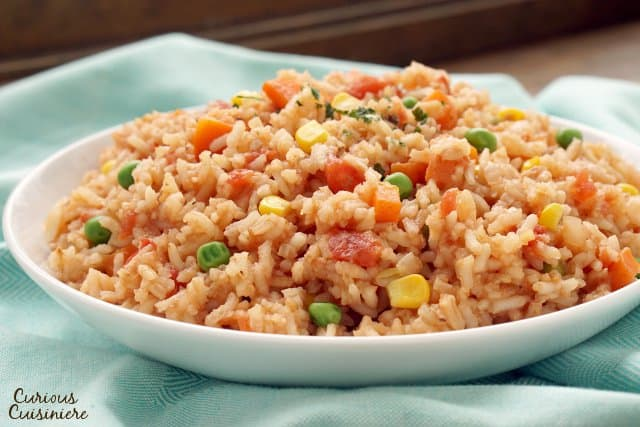 Arroz Rojo is a Mexican rice dish with many names. Whether you know it by the name Spanish Rice or Mexican Red Rice, this side dish is a tasty accompaniment to any meal.| www.CuriousCuisiniere.com