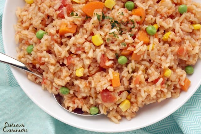 Arroz Rojo is a Mexican rice dish with many names. Whether you know it by the name Spanish Rice or Mexican Red Rice, this side dish is a tasty accompaniment to any meal. | www.CuriousCuisiniere.com