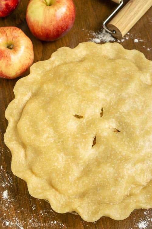 This Brandy Apple Pie has a (not so) secret ingredient that adds some serious flavor to theAmerican classic! We're using an oil pie crust to add extra tenderness to this delicious pie. This is definitely a fall baking recipe that you need to try! | www.CuriousCuisiniere.com