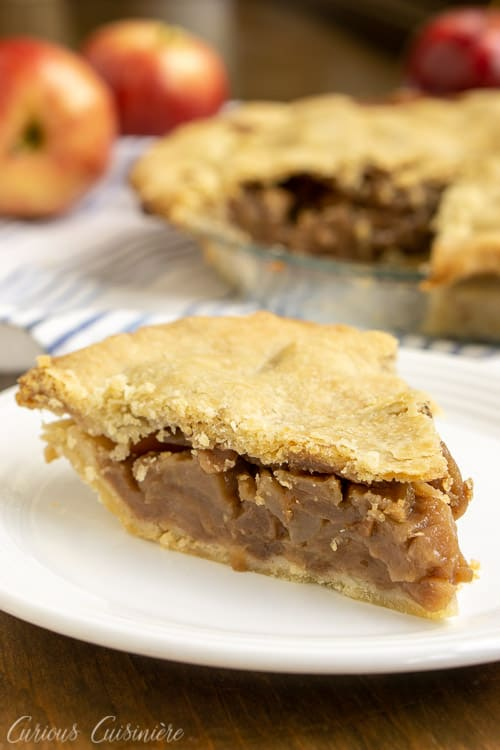 This Brandy Apple Pie has a (not so) secret ingredient that adds some serious flavor to theAmerican classic! We're using an oil pie crust to add extra tenderness to this delicious pie. This is definitely a fall baking recipe that you need to try!   www.CuriousCuisiniere.com