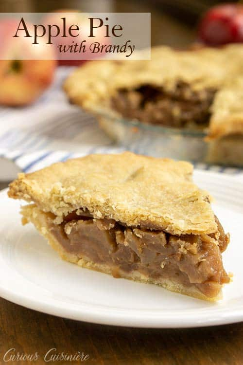 This Brandy Apple Pie has a (not so) secret ingredient that adds some serious flavor to theAmerican classic! We're using an oil pie crust to add extra tenderness to this delicious pie. This is definitely a fall baking recipe that you need to try! #applepie #pie #fall | www.CuriousCuisiniere.com