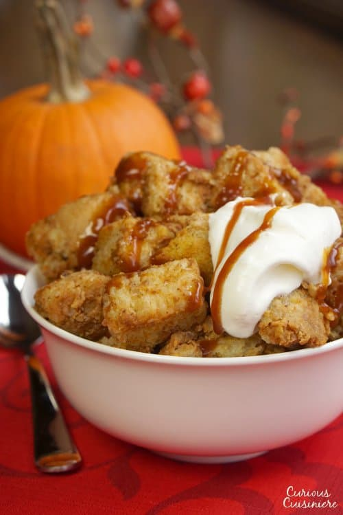 Just as good as warm pumpkin pie, this crock pot pumpkin bread pudding recipe is healthy enough for a fall breakfast, but it's enough of a treat, that it makes a wonderful dessert too! | www.CuriousCuisiniere.com