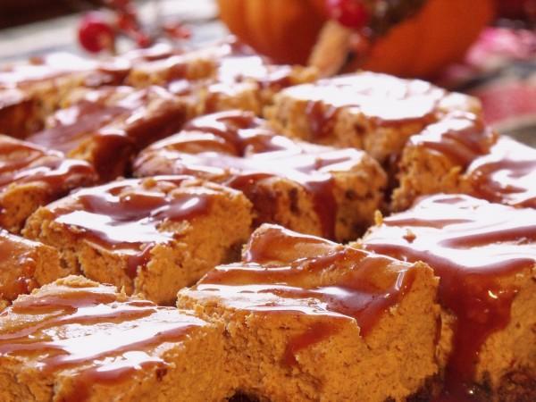 Bring a new dimension to a classic fall dessert recipe by transforming pumpkin pie into decadent pumpkin cheesecake bars. | www.CuriousCuisiniere.com