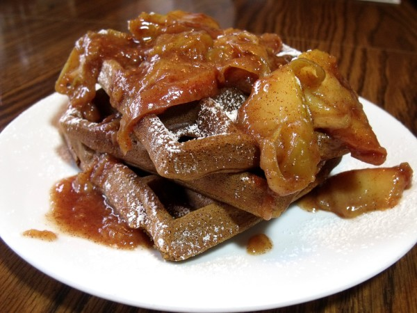 Flavorful Gingerbread Waffles bring the flavor of a gingerbread cookie to breakfast. They are extra perfect when topped with a warm Cinnamon Apple Topping. - Curious Cuisiniere