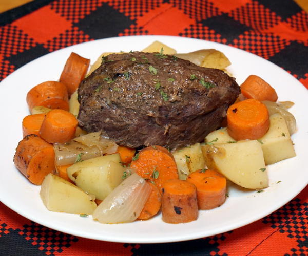 Braising is the perfect technique for cooking venison roasts and this Beer Braised Venison recipe brings a German flair and intense flavor that are destine to be a family favorite. | www.curiouscuisiniere.com