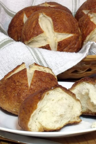 If you love soft pretzels, you will love the dense, chewy dough and beautifully browned, salty crust of Laugenbroetchen, or German pretzel rolls. | www.CuriousCuisiniere.com