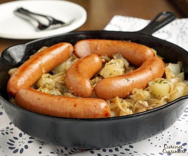 Polish Sausage and Sauerkraut are a match made in heaven. Add some potatoes and onions, and you have yourself a full meal! | www.CuriousCuisiniere.com