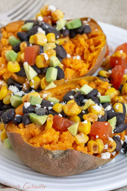Our Southwest Stuffed Sweet Potatoes are filled with a homemade corn salsa, queso fresco, avocado, and black beans for a nutrient rich twist on a loaded baked potato. | www.CuriousCuisiniere.com