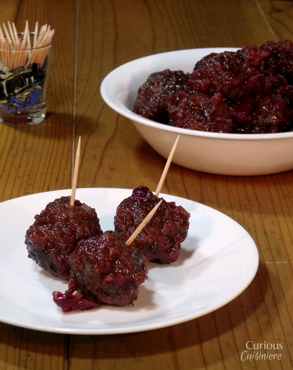Sweet and slightly tangy cranberries make the perfect glaze for these Venison Meatballs that pack just a slight cayenne kick. - Cranberry Glazed Meatballs - Curious Cuisiniere