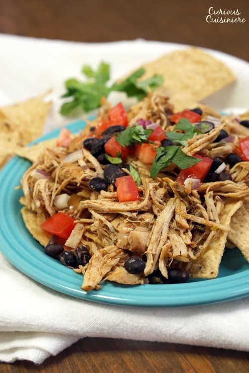 Smoky and slightly spicy, this Crock Pot Southwest Pulled Chicken is as flavorful as it is versatile and easy to make. | www.CuriousCuisiniere.com