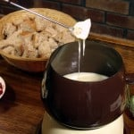 Cheese, garlic, white wine, and bread. What more do you need to enjoy a cool winter night than a big pot of Swiss fondue?