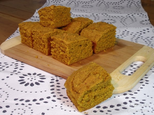 A deeply flavorful and moist pumpkin cornbread, this recipe for Pumpkin Cornbread makes a great addition to a hearty winter meal or a nice fall snack all on its own. | Curious Cuisiniere