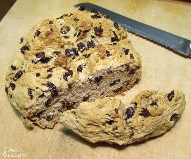 This Irish Soda Bread with Raisins recipe produces a hearty biscuit-like loaf with a hint of raisin sweetness. Perfect for breakfast but also mild enough to pair well with a thick Irish stew.   www.CuriousCuisiniere.com