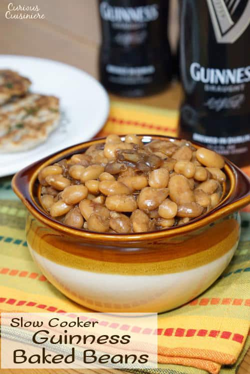 Not your classic sweet and sticky BBQ Baked Beans, these Guinness Baked Beans boast a mild and malty sweetness with a deep and robust flavor. | www.CuriousCuisiniere.com