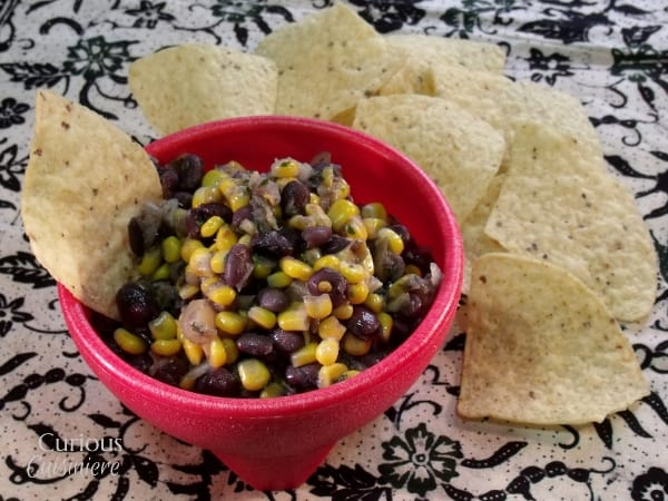 Sweet and Tangy Pineapple Black Bean Salsa via Curious Cuisiniere