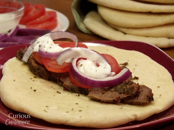 Venison steak (or beef) is sliced thin, marinated, and piled on flatbread to create these Venison Gyros, a easy twist on the classic Greek street food. - Venison Steak Gyros from Curious Cuisiniere