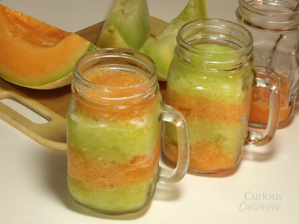 This layered Melon Granita combines brightly colored layers of sweet honeydew granita and spiced cantaloupe granita make a sweet, guilt free summer treat. | Curious Cuisiniere