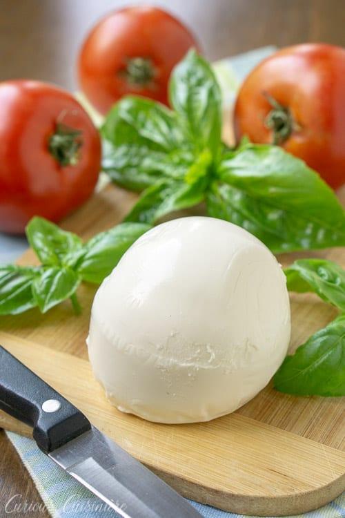 Fresh mozzarella, basil, and tomatoes for Insalata Caprese ( Caprese Salad). | www.CuriousCuisiniere.com