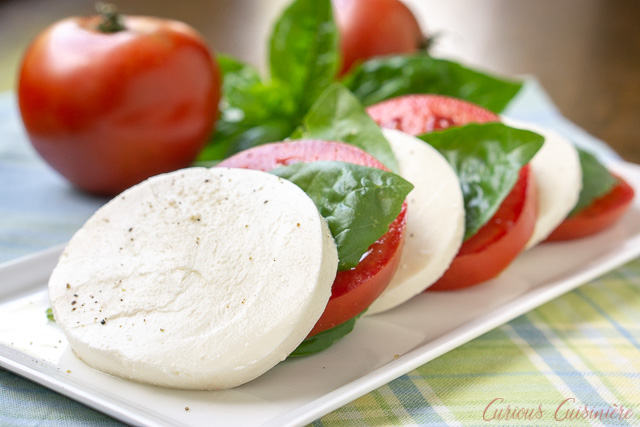 Insalata Caprese (or Caprese Salad) with juicy tomatoes, fresh basil, and soft mozzarella cheese. | www.CuriousCuisiniere.com