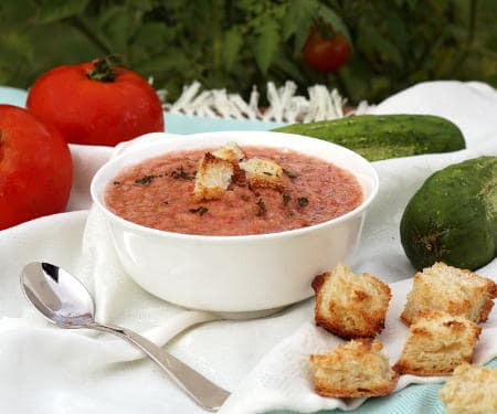 There is more than meets the eye to this chilled, Spanish soup. Gazpacho is a refreshing and flavorful chance to serve up summer in a bowl! | www.CuriousCuisiniere.com
