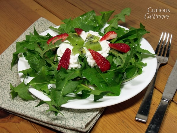 Strawberry Kiwi Salad with Dandelion Greens from Curious Cuisiniere