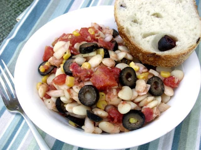 Mediterranean Lima Bean Succotash is a fusion dish that combines Lima beans and corn with Mediterranean herbs to create a summery twist on a classic succotash. | www.CuriousCuisiniere.com