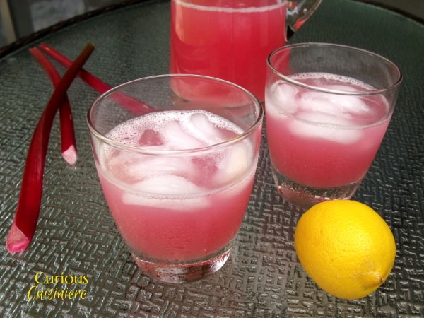 This Rhubarb Lemonade brings a unique sweet and tart twist to the refreshing summer classic drink. | Curious Cuisiniere