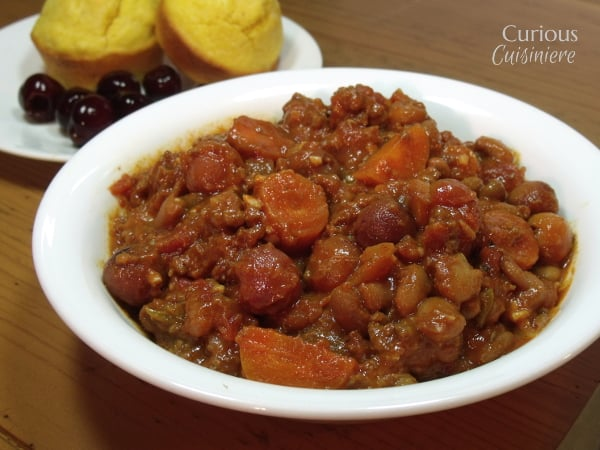 Tart cherries lend their fruity, tart flavors to this hearty beef and bean chili in this Tart Cherry Chili that is lightly sweet and super satisfying. | Curious Cuisiniere
