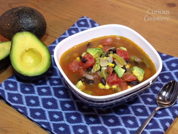 Mexican Minestrone with Avocados from Curious Cuisiniere - This Mexican Vegetable Soup uses healthy avocados for added nutrition and a creamy texture. We're calling it Mexican Minestrone for a fun fusion!