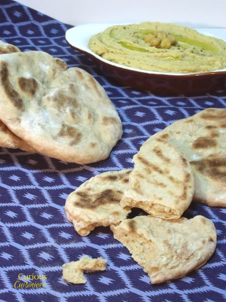 This chewy Roasted Garlic Flatbread is delicious with hummus or a warm curry. | Curious Cuisiniere