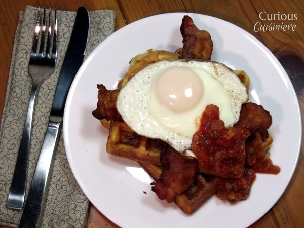 Cornmeal Herb Waffles with Fried Eggs from Curious Cuisiniere