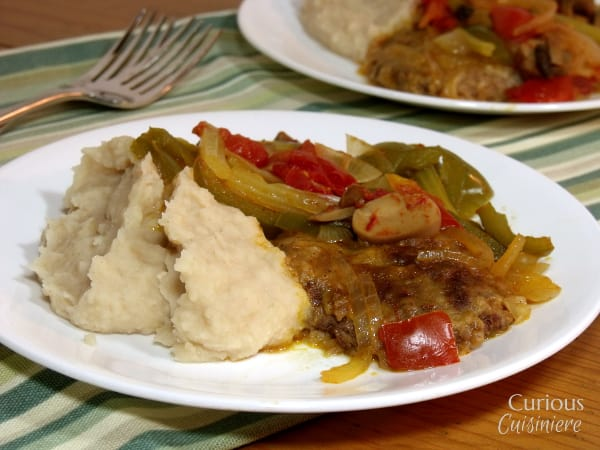 Tender steak is slow simmered in a veggie mixture for perfectly combined flavors that create a heavenly combo when this Swiss Steak is paired with mashed potatoes.   www.cuiouscuisiniere.com