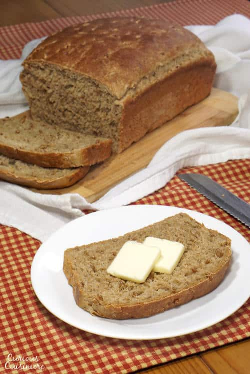 This Wheat Berry Bread is a soft, yet hearty bread that reminds us of Germany with its deep, malty sweetness and nutty, soaked wheat berries. | www.CuriousCuisiniere.com