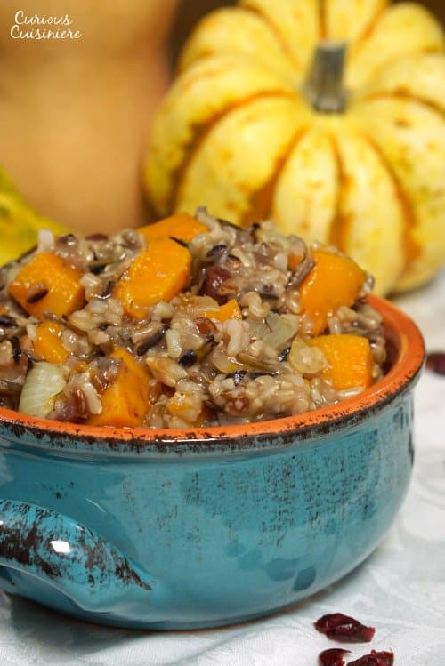 This hearty Butternut Squash Wild Rice Pilaf with Cranberries makes a delicious fall side dish or Thanksgiving stuffing! | www.CuriousCuisiniere.com