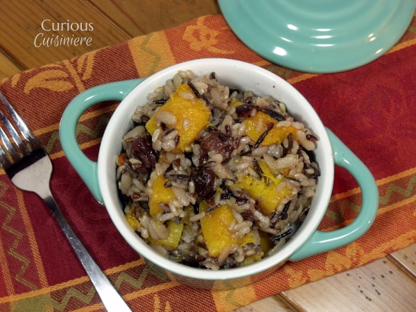 This hearty Butternut Squash Wild Rice Pilaf makes a delicious fall side dish or Thanksgiving stuffing! | www.CuriousCuisiniere.com