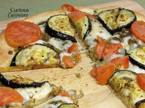 Garlic, oregano and a homemade pesto make this Roasted Zucchini Pizza a recipe that you do not want to miss! |  Curious Cuisiniere