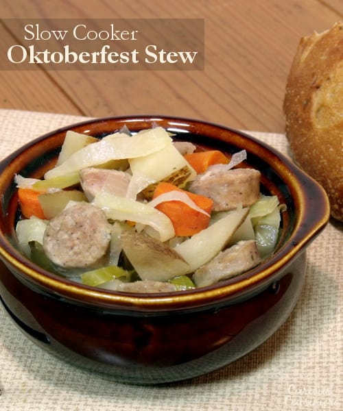 Bratwurst, potatoes, cabbage, and carrots mingle in this hearty Slow Cooker Oktoberfest Stew that gets an extra pump of flavor from a good dose of German beer. | CuriousCuisiniere.com