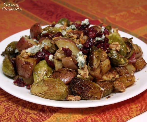 This recipe for Roasted Brussels Sprouts with Cranberries brings savory and sweet fall flavors together for one incredibly tasty side dish for your holiday table. | www.curiouscuisiniere.com
