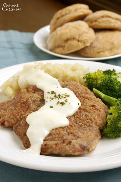 Country Fried Venison Steak with white pepper gravy and biscuits.