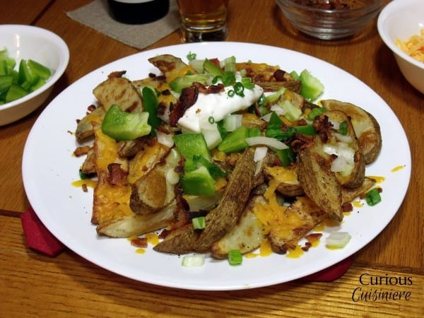 Loaded Baked Potato Nacho Bar from Curious Cuisiniere
