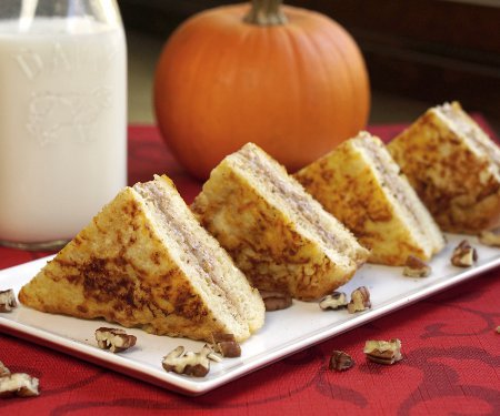 Pumpkin pie becomes the perfect, elegant fall breakfast with this recipe for Pumpkin Stuffed French Toast.  | www.CuriousCuisiniere.com