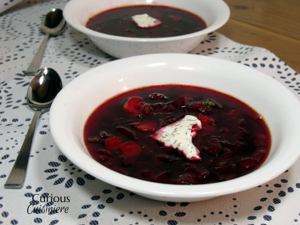 Our Polish Borscht recipe (Barszcz) is chock full of veggies and boasts a bright, sweet and sour flavor that makes it a perfect first course or warming meal. | Curious Cuisiniere