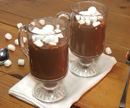 This rich dark hot chocolate recipe isn't for the faint of heart. If you like rich, creamy, dark chocolate, this homemade hot chocolate is for you.   www.CuriousCuisiniere.com