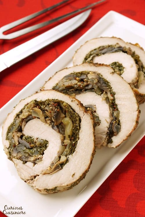 Mushrooms sauteed in wine and mustard pairs perfectly with sweet Swiss chard in this Rolled Pork Loin Roast. | www.CuriousCuisiniere.com