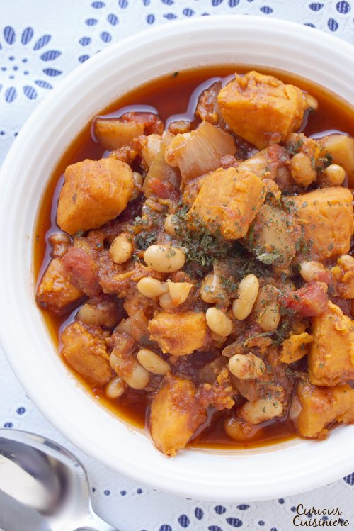 Bring a new take to fall chili with this slow cooker Sweet Potato White Bean Chili. This hearty, vegetarian meal brings warm spices together with hearty root vegetables and is sure to leave you satisfied!   www.CuriousCuisiniere.com