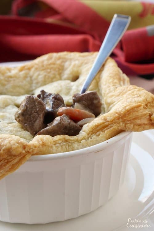 These individual Beef Burgundy Pot Pies evoke all the slow-cooked flavor of a traditional French Boeuf Bourguignon, with an added flaky pastry top! | www.CuriousCuisiniere.com
