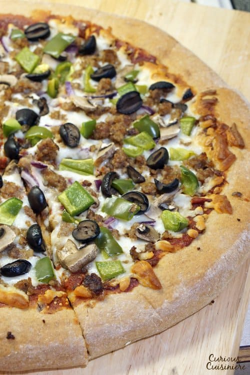 Making pizza is incredibly simple when you break out your bread machine! This Bread Machine Whole Wheat Pizza Dough recipe is so easy, you'll want homemade pizza every night! | www.CuriousCuisiniere.com