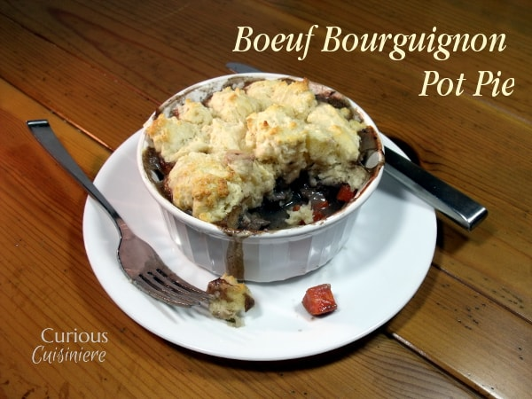 These individual Beef Burgundy Pot Pies evoke all the slow-cooked flavor of a traditional French Boeuf Bourguignon, with an added biscuit topping! | Curious Cuisiniere