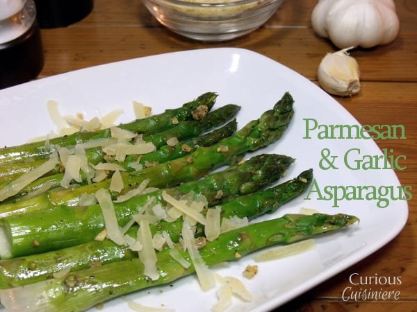 Parmesan cheese adds a richness to these garlic and lemon flavored asparagus spears. They make the perfect spring and Easter side dish. | Curious Cuisiniere